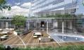 V prvním vizuálním zlomu fasády umístěné stromy i venkovní a krytý bazén