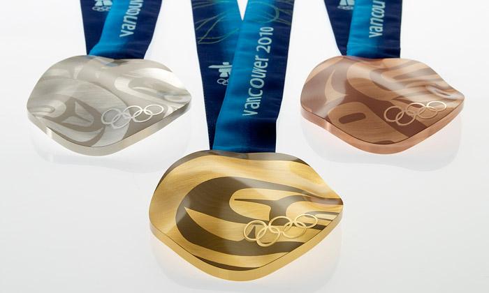 Vancouver rozdal první zvlněné olympijské medaile