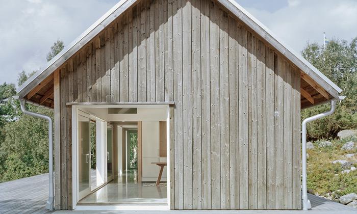 Letní domek veŠvédsku vsadil napřírodní materiály