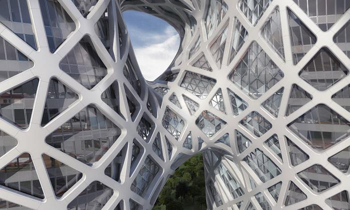 Zaha Hadid staví hotel sdírami asnovým interiérem
