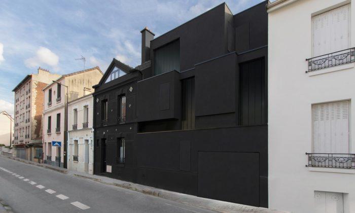 U Paříže rozšířili dům z19.století omoderní kvádry acelý jej oblékli dočerné