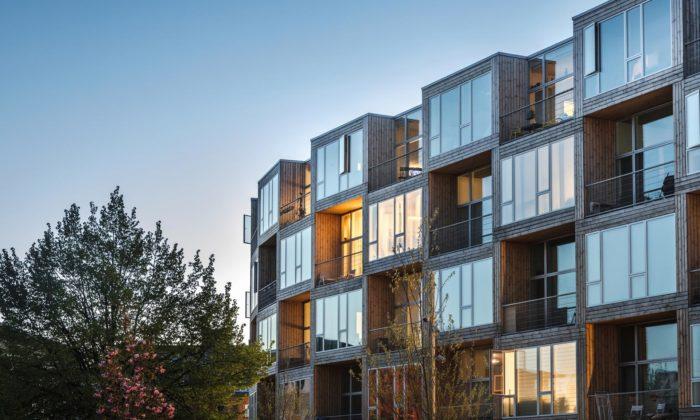 BIG postavili vKodani cenově dostupné bydlení vbytovém domě zdřevných kostek