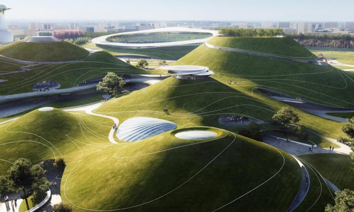 MAD staví futuristický sportovní kampus sestadiony ukrytými vzelených kopcích