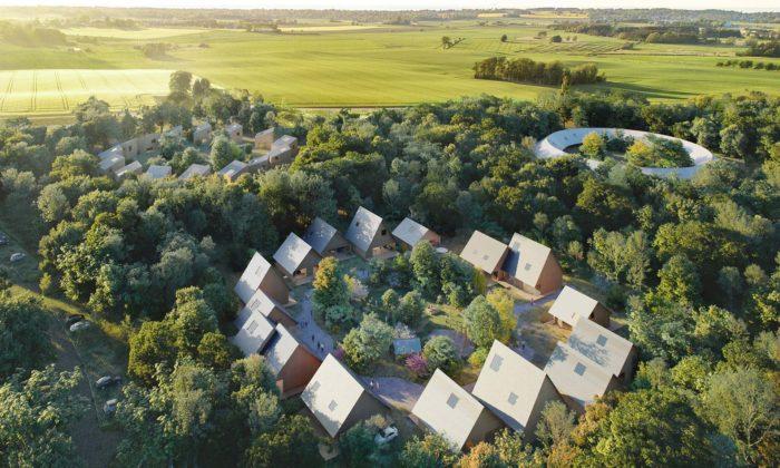Dánsko postaví obytnou čtvrť nového typu sdomy dokruhu aobklopené lesem