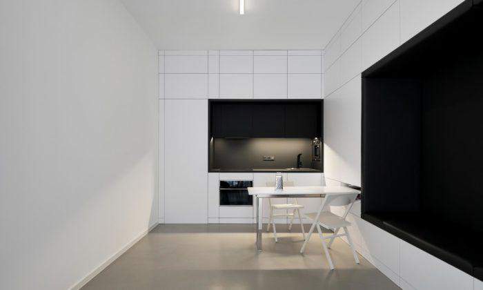 Dvacetimetrový průchozí pokoj vPraze spojuje obývák skuchyní ajídelnou